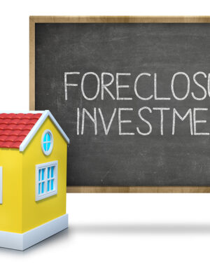 Foreclosure investment on blackboard with 3d house front of blackboard on white background