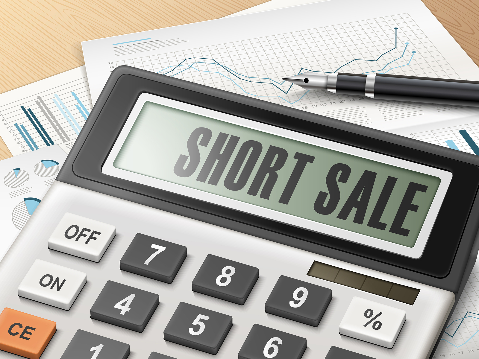 calculator with the word short sale on the display